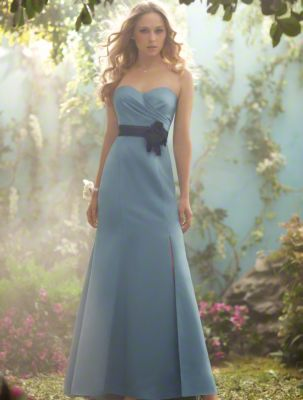 A Gorgeous Bridesmaid Standing In A Blue, Sweep Train Length Disney Bridesmaid Dress With A Contrasting Belt And Side Front Slit