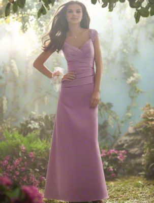 An Alluring Bridesmaid Wearing A Pink, Floor Length Disney Bridesmaid Dress With Cap Sleeves