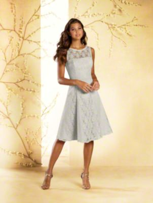 A short princess bridesmaid dress with sheer yoke, princess line waist, and softly flared skirt with side pockets.