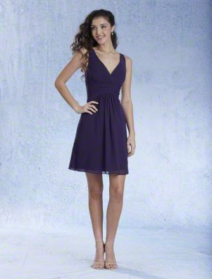 A Cocktail Length, A-Line Style, Short Bridesmaid Dress With A V-Shaped Neckline And Cross-Over Back Straps.