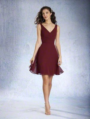 A Cocktail Length, A-Line Style, Short Bridesmaid Dress With A V-Shaped Neckline And Circular Cut Skirt.