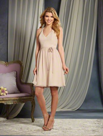 A Cocktail Length, A-Line Style, Short Bridesmaid Dress With A V-Shaped Neckline, Racerback Detail And A Natural Waist With Belt And Bow.