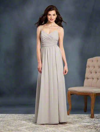 A Full Length, A-Line Style, Long Bridesmaid Dress With Double Spaghetti Straps And A Side Slit Skirt.