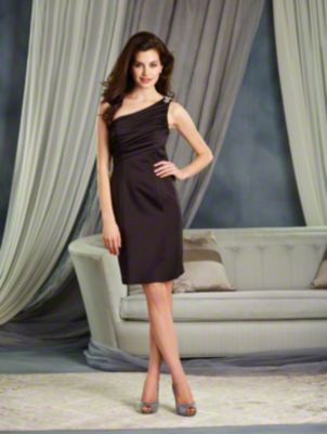 A Cocktail Length, One Shoulder Bridesmaid Dress With An Asymmetric Empire Waist And Beaded Motif Detail On The Strap.