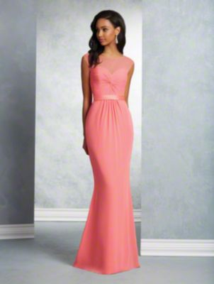 A long beautiful bridesmaid gown with sweetheart neckline, sheer yoke, cap sleeves, keyhole back, and fluted skirt.