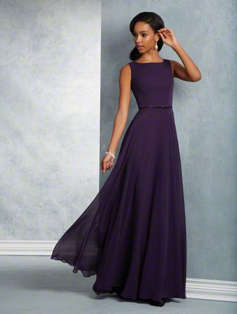 A long, romantic bridesmaid dress with a sleeveless, bateau neckline, keyhole back, natural waist, and circle skirt.
