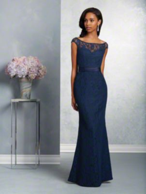 A long, beautiful bridesmaid gown with a sweetheart neckline, sheer bateau yoke with cap sleeves, and fluted skirt.