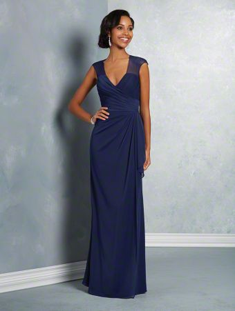 A long, affordable bridesmaid dress with a V-neckline, sheer cap-sleeved yoke, keyhole back, and fluted skirt.
