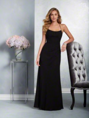 A long, beautiful bridesmaid dress with a dipped neckline, halter spaghetti straps, racerback detail, and fluted skirt