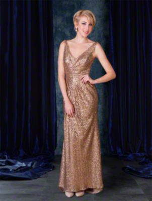 A full length sequined sexy bridesmaid gown with v-neckline, shoulder straps, cummerbund, pleated skirt, and sweep train.