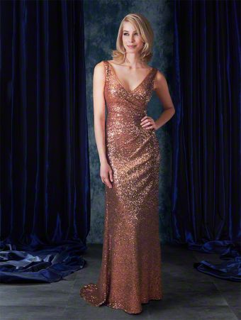 A full length sequined glamorous bridesmaid dress with v-neckline, shoulder straps, draped body, and sweep train.
