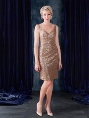 A cocktail length sequined elegant bridesmaid dress with v-neckline, shoulder straps, and draped body and skirt.