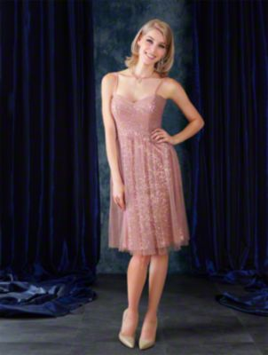 A cocktail length luxurious bridesmaid dress with spaghetti straps, sweetheart neckline, natural waist, and draped skirt.