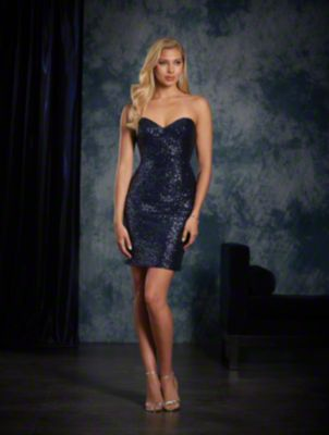 A short sexy bridesmaid dress in sequins with a strapless, sweetheart neckline, sheath silhouette, and cocktail skirt.