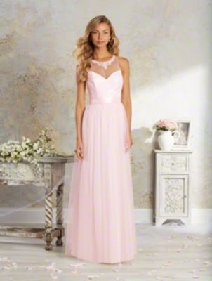 A long, romantic bridesmaid dress with a sheer yoke over sweetheart neckline, keyhole back, natural waist, and gathered skirt.