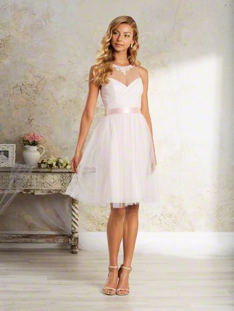 A short, elegant bridesmaid dress with a sheer yoke over sweetheart neckline, keyhole back, natural waist, and cocktail skirt.