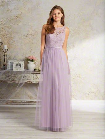 A long, boho chic bridesmaid dress with sleeveless lace yoke over sweetheart neckline, natural waist, and gathered skirt.