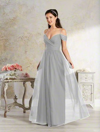 A long, shabby chic bridesmaid dress with spaghetti straps, arm drapes, draped bodice, and full-length skirt.