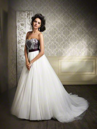 A Beautiful Bride Wearing A Full Length, Ball Gown Silhouette, Classic Wedding Dress, With A Blushed Bodice And Satin Accent Waistband.
