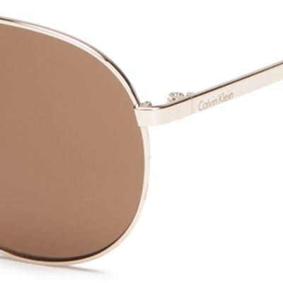 Calvin Klein Accessories: Gold Calvin Klein Rounded Metal Aviator With Logo Sunglasses