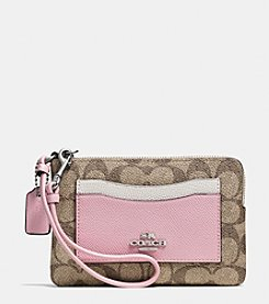 COACH CORNER ZIP WRISTLET IN COLORBLOCK SIGNATURE COATED CANVAS