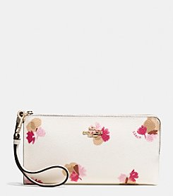 COACH ZIP WALLET IN FLORAL PRINT COATED CANVAS