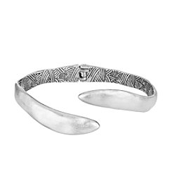 The Sak® Silvertone Open Spring Textured Bangle Bracelet