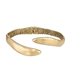 The Sak® Goldtone Open Spring Textured Bangle Bracelet