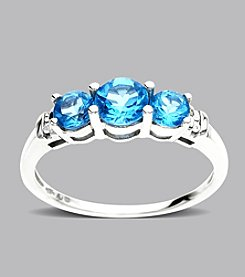 Three Stone Blue Topaz Ring in 10K White Gold