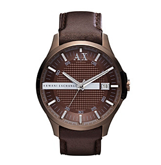 Rich chocolate colored construction highlighted with silvertone details lends a unique charm to this leather and stainless steel watch.