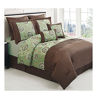 Exclusively ours! Simply stylish and luxuriously comfortable, the Emily comforter set from LivingQuarters will bring a welcome pop of color to your bedroom.