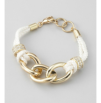 White rope tied with slip knots and set with simulated crystal pave charms suspend goldtone links in this nautical bracelet by GUESS.