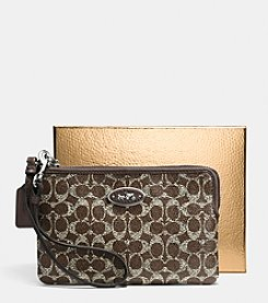 COACH SMALL L-ZIP WRISTLET IN SIGNATURE COATED CANVAS