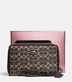 COACH ZIP AROUND UNIVERSAL WALLET IN EMBOSSED SIGNATURE CANVAS