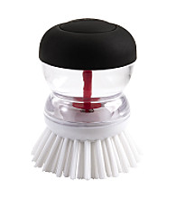 OXO® SteeL Soap Squirting Palm Brush