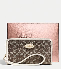 COACH UNIVERSAL ZIP CASE IN EMBOSSED SIGNATURE CANVAS
