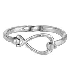 The Sak® Silvertone Twist Spring Bangle Bracelet
