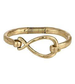 The Sak® Goldtone Twist Spring Bangle Bracelet