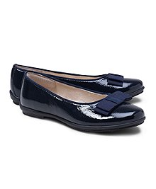 Patent leather with rubber sole. Navy satin ribbon. Imported.