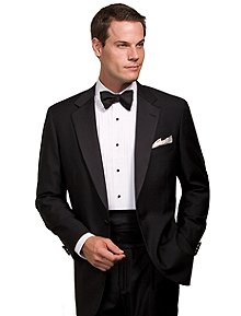 Our elegant tuxedo is impeccably tailored in pure wool for a luxurious drape. Satin-covered buttons. Full Bemberg lining. Dry clean. Made in the USA.