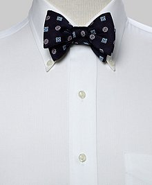 Pure silk woven in England. Dry clean. Made in the USA. Self-tie bow.