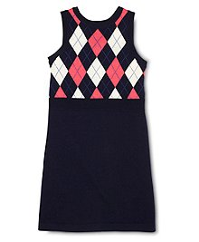 Soft merino wool knitted into a sleeveless dress. Iconic argyle knit on top with solid bottom. Ribbed detailing at neck, armhole and waist. Hits above the knee. Dry clean. Imported.