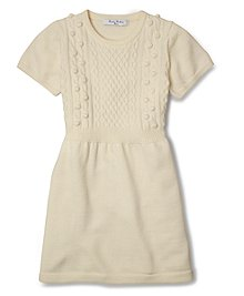Short-sleeve sweater dress knit in our soft merino wool. Popcorn stitching on front chest. Jersey knit back, sleeves and skirt. Dry clean. Imported.