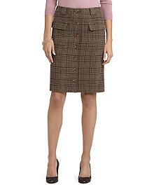 "Lambswool A-line button-front plaid skirt. Patch pockets. Corozo  buttons along center front. Fully lined. 23"" center back length.  Dry clean. Imported."