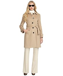 "Belted button-front coat made  from premium Loro Piana® wool  fabric, woven in Italy. Pockets. Belts along waist and sleeve cuffs.  Fully lined. 40"" center back length. Dry clean only. Imported."