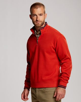 Heritage Half Zip The perfect pullover for transitional weather, our Heritage Half Zip features striped trim at the ribbed collar and cuffs, ribbed trim at the hem and contrast paneling along the sides. 81% cotton, 19% polyester. Machine wash cold, delicate. Tumble dry low, delicate.