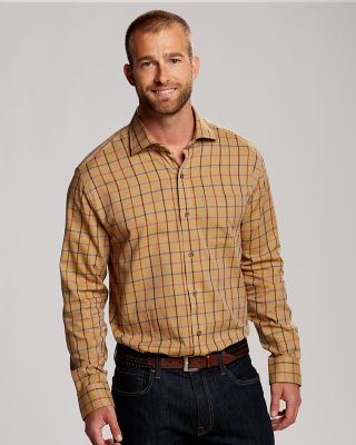 L/S James Plaid A classic plaid in an array of warm fall colors, our James Plaid features a twill weave, spread collar, chest patch pocket, button cuffs, and contrasting chambray piping at the inside collar stand. 100% cotton. Machine wash cold, delicate. Tumble dry low, delicate.