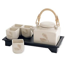 Handmade ivory celadon pottery from Thailand's Chiang Mai region is gently shaped into a teapot and four teacups. This tea set is decorated with a raintree leaf under crackled, lead-free glaze. Mango- :  handmade tea pot teapot teacup