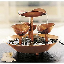 Bring the healing element of water into your environs with our handcrafted solid Copper Petals Fountain. Water is pumped through a curved petal-like centerpiece, pours into an elegant three-cup spiral