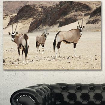 Designart Beautiful Wildebeests On Valley Landscape Artwork Canvas 3 Panels
